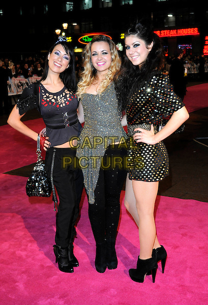 "GIRLS CAN'T CATCH - DAIZY, PHOEBE & JESS .Attending the UK Film Premiere of ""St. Trinian's 2: The Legend Of Fritton's Gold"" at Empire Leicester Square, London,  England, UK, December 9th 2009..Trinians St arrivals full length girls girl group band  black polka dot silver gold dress ankle boots hand on hip trousers bag top sparkly .CAP/FIN.©Steve Finn/Capital Pictures."