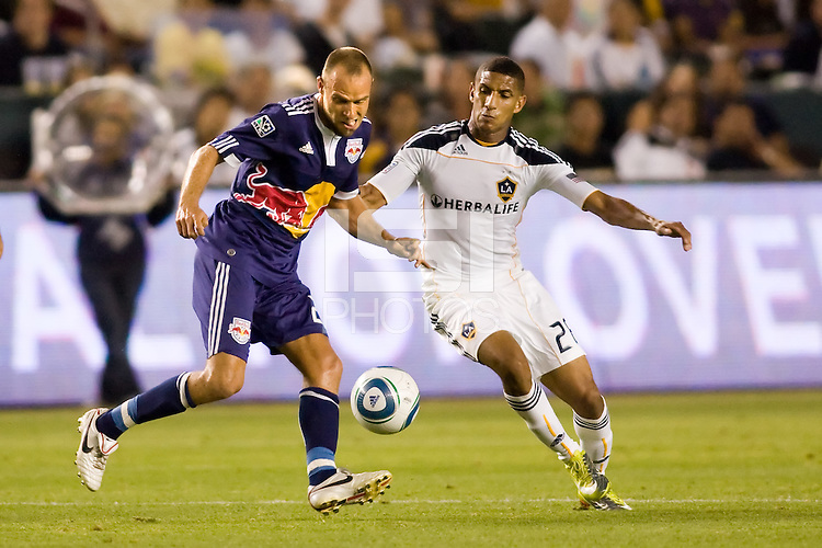 Joel Lindpere forward of the New York Red Bulls battles LA Galaxy defender Sean Franklin. The New York Red Bulls beat the LA Galaxy 2-0 at Home Depot Center stadium in Carson, California on Friday September 24, 2010.