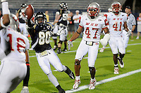 6 December 2008:  FIU wide receiver Jason Frierson (80) celebrates a touchdown as Western Kentucky defensive back Trent Calhoun (47) and linebacker Taurean Smith (41) look on in the fourth quarter of the FIU 27-3 victory over Western Kentucky at FIU Stadium in Miami, Florida.