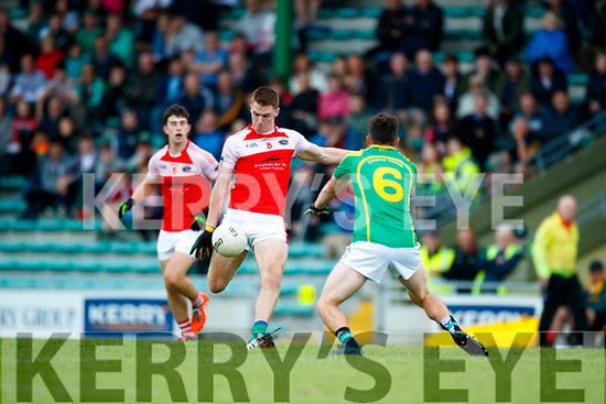 Oran Clifford South Kerry in action against Barry O'Sullivan Dingle in the Quarter Final of the Kerry Senior County Championship at Austin Stack Park on Sunday.