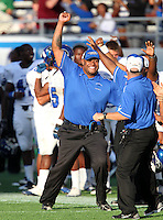 Armwood Hawks coaches celebrate the clinching play during the fourth quarter of the Florida High School Athletic Association 6A Championship Game at Florida's Citrus Bowl on December 17, 2011 in Orlando, Florida.  Armwood defeated Miami Central 40-31.  (Mike Janes/Four Seam Images)