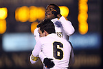 24 November 2013: Wake Forest's Sean Okoli (behind) celebrates his goal with Ross Tomaselli (6). The Wake Forest University Demon Deacons played the Naval Academy Midshipmen at Spry Stadium in Winston-Salem, NC in a 2013 NCAA Division I Men's Soccer Tournament Second Round match. Wake Forest won the game 2-1.