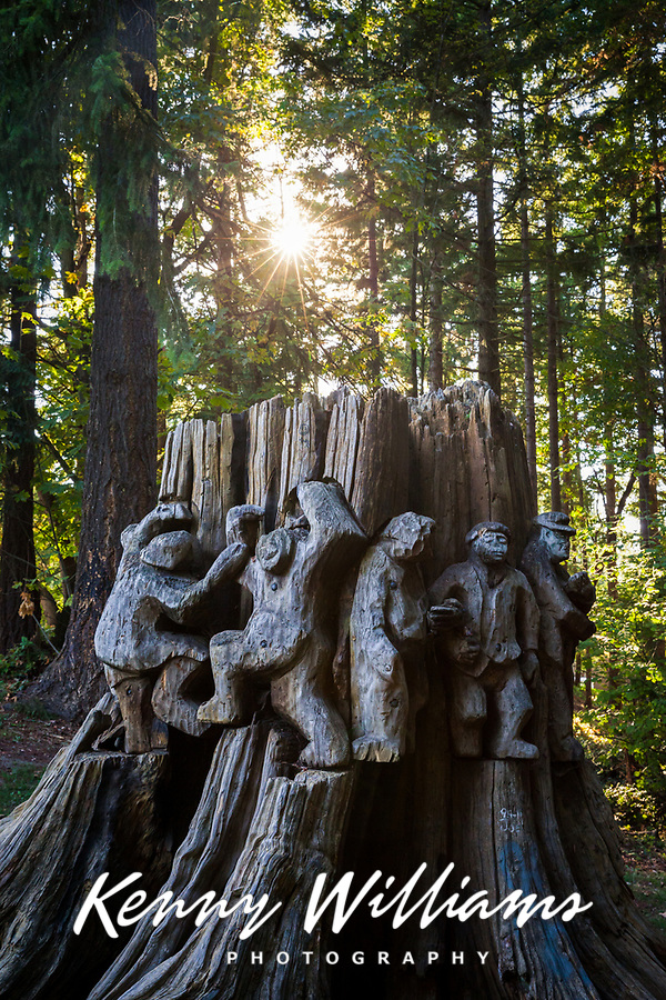 """Wobblies Dancing"" old growth cedar stump carving by Northwest artist and sculptor Richard Beye, Dottie Harper Park, Burien, Washington State, WA, America, USA."