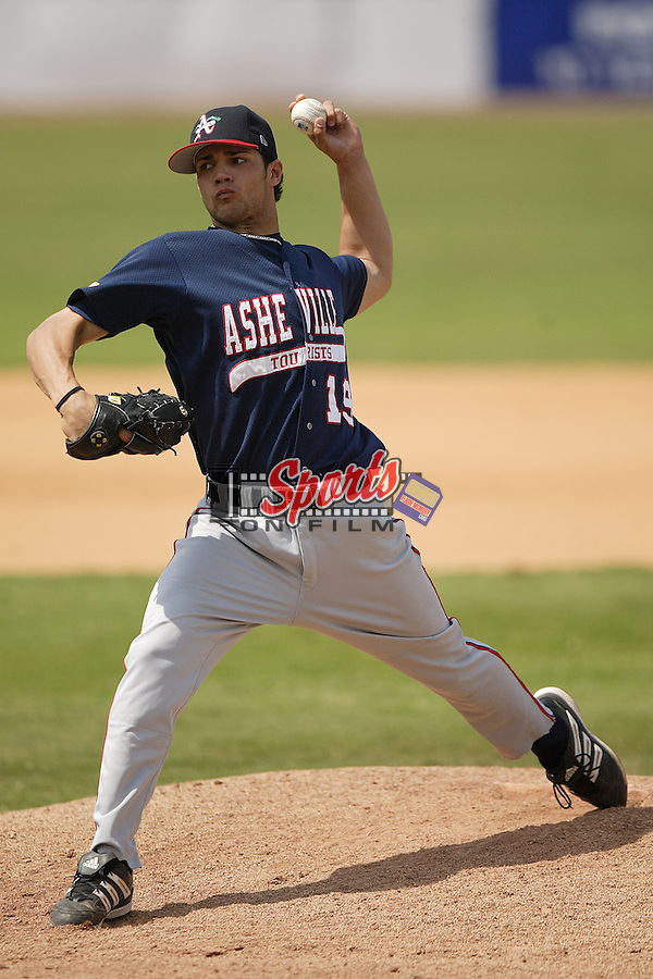 Asheville starting pitcher Xavier Cedeno (19) winds up to deliver a pitch versus Hickory at L.P. Frans Stadium in Hickory, NC, Sunday, May 21, 2006.  Hickory defeated Asheville 5-4.