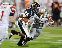 6 December 2008:  FIU defensive back Chuck Grace (26) runs back an interception in the fourth quarter of the FIU 27-3 victory over Western Kentucky at FIU Stadium in Miami, Florida.