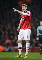 FUSSBALL  CHAMPIONS LEAGUE  ACHTELFINALE  HINSPIEL  2012/2013      FC Arsenal London - FC Bayern Muenchen       19.02.2013 Per Mertesacker (Arsenal)