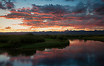 Idaho, eastern, Driggs, Sunrise over the Teton Range and Teton valley and river in summer.