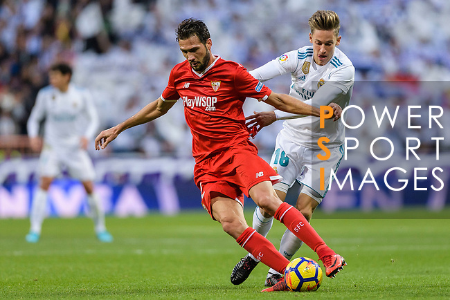 Marcos Llorente of Real Madrid (R) fights for the ball with Franco Vazquez of Sevilla FC (L) during La Liga 2017-18 match between Real Madrid and Sevilla FC at Santiago Bernabeu Stadium on 09 December 2017 in Madrid, Spain. Photo by Diego Souto / Power Sport Images