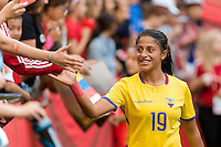 June 12, 2015: Kerlly REAL of Ecuador greets fans after a Group C match at the FIFA Women's World Cup Canada 2015 between Switzerland and Ecuador at BC Place Stadium on 12 June 2015 in Vancouver, Canada. Switzerland won 10-1. Sydney Low/AsteriskImages