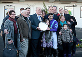 The Busanda Stakes trophy presentation to owner Ed Stanco (with plate) and company.