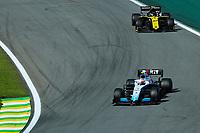 17th November 2019; Autodromo Jose Carlos Pace, Sao Paulo, Brazil; Formula One Brazil Grand Prix, Race Day; Robert Kubica (POL) Williams Racing FW42 and Nico Hulkenberg (GER) Renault Sport F1 Team RS19 - Editorial Use