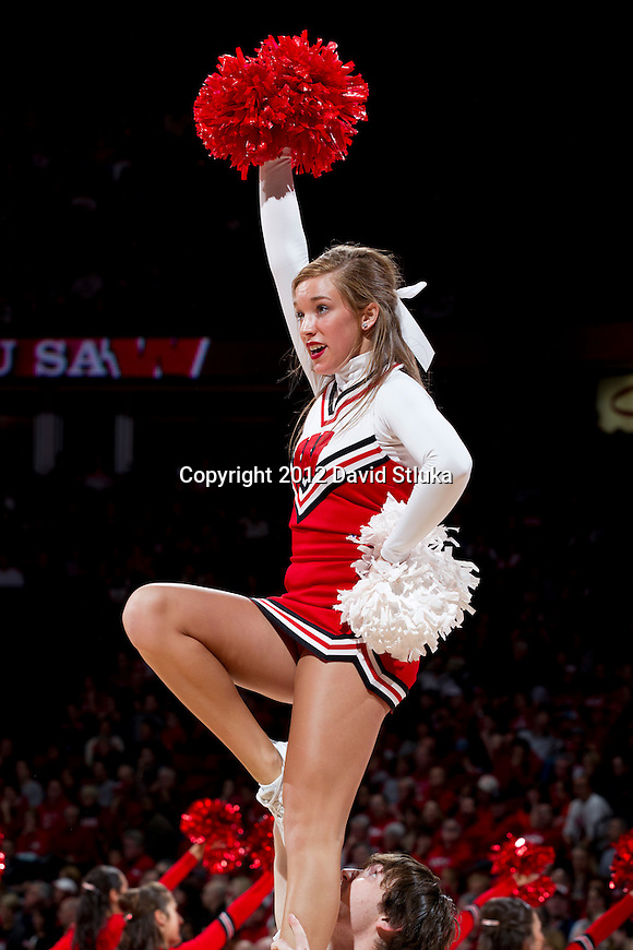 Wisconsin Badgers cheerleader cheers during a Big Ten Conference NCAA college basketball game against the Illinois Fighting Illini on Sunday, March 4, 2012 in Madison, Wisconsin. The Badgers won 70-56. (Photo by David Stluka)