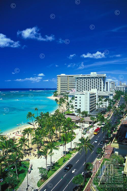 View of Waikiki Beach and Kalakaua ave.on a sunny hawaiian day.Hotels seen are Sheraton Moana Surfrider,Ourigger Waikiki and Sheraton Waikiki.