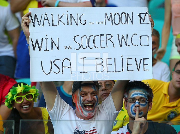 A USA fan holds up a banner saying 'USA I Believe'