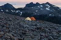 Tents on rocky summit of Støvla mountain peak, Moskenesøy, Lofoten Islands, Norway