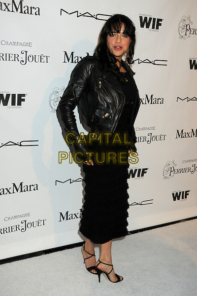 MICHELLE RODRIGUEZ .3rd Annual Women In Film Pre-Oscar Party held at a Private Residence in Beverly Hills, California, USA, .4th March 2010..full length black leather jacket long maxi dress sandals biker .CAP/ADM/BP.©Byron Purvis/AdMedia/Capital Pictures.