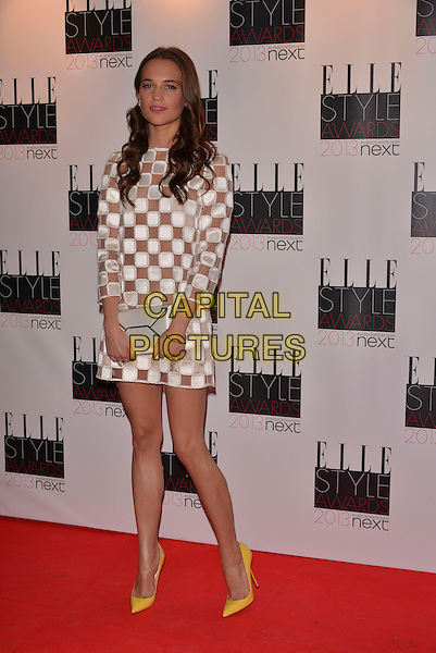 Alicia Vikander.The Elle Style Awards 2013 arrivals, The Savoy Hotel, London, England..11th February 2013.full length white sheer squares yellow shoes dress clutch bag silver pattern.CAP/PL.©Phil Loftus/Capital Pictures