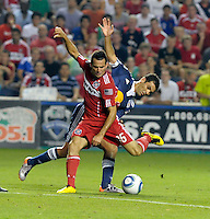 Chicago midfielder Marco Pappa (16) shoots while being pressured by New York defender Rafael Marquez (4).  The Chicago Fire tied the New York Red Bulls 0-0 at Toyota Park in Bridgeview, IL on August 8, 2010