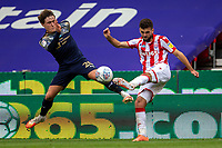 4th July 2020; Bet365 Stadium, Stoke, Staffordshire, England; English Championship Football, Stoke City versus Barnsley; Tommy Smith of Stoke City clears the ball past Callum Styles of Barnsley