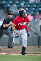 Raudy Read (21) of the Potomac Nationals hustles down the first base line against the Winston-Salem Dash at BB&T Ballpark on May 13, 2016 in Winston-Salem, North Carolina.  The Dash defeated the Nationals 5-4 in 11 innings.  (Brian Westerholt/Four Seam Images)