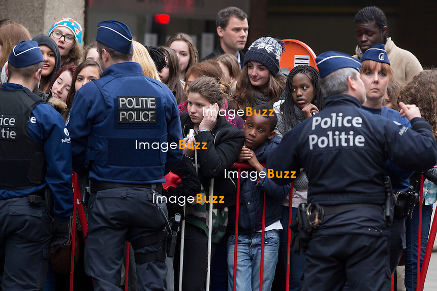 "Justin Bieber touring in Belgium - Justin Bieber arrived from France in Belgium-Brussels,  on April 9th at 4 am with his black/grey touring bus ""  Beat the streets ""..He checked into the  "" Steigenberger ""  hotel in Brussels. A few hours later, his fans were surrounding the front and back entrance of his hotel, that the security of the hotel could not handle such a craziness and had to get some big help from the brussels police. About 40 police officers arrived to surround the hotel to protect the star who had two concerts in the city of Antwerp. But Justin asked the police to leave, which they did after a while!! Justin kept hiding in the hotel between the fitness center kept opened only for him, as well the swimming pool where he did some water polo with his musicians. The bar of the hotel even got closed to the guests of the hotel around 6pm, to let justin enjoying the bar. On the first day of his concert, Justin escaped his fans by jumping from his Mercedes van into his tour bus, hided by his bodyguards. Justin's musicians even played the piano at the piano bar  of the hotel, singing Elton John's songs! It's only on his 3rd and last day in Brussels  ( April11th ) that Justin Bieber finally agreed to meet with his fans on the street. Brussels, April 10th & 11th, 2013..Pictured : fans waiting for Justin Bieber in front of his Brussel's hotel"