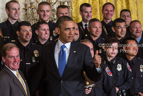 United States President Barack Obama poses for a picture with the 2013 National Association of Police Organizations TOP COPS award winners during a ceremony honoring them at the White House on May 11, 2013 in Washington, DC. TOP COPS awardees are nominated by their fellow officers for outstanding service above and beyond the call of duty. <br /> Credit: Brendan Hoffman / Pool via CNP
