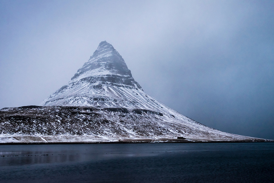GRUNDARFJOROUR, ICELAND - CIRCA MARCH 2015: Kirkjufell mountain near Grundarfjordur, a landmark in the Snaefellsness Peninsula.