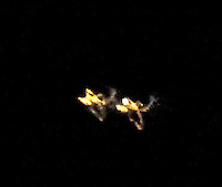The Space Cowboys; two UFO craft showing identical bilateral symmetry/design.