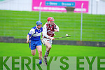 Causeway's Tommy Casey gets away from Ardfert's Daniel Casey in the U21 hurling semi-final at Austin Stack, Tralee on Sunday.