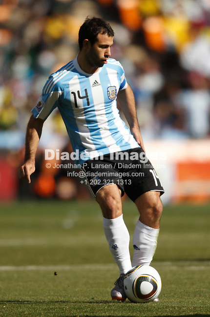 JOHANNESBURG - JUNE 17:  Team captain Javier Mascherano of Argentina passes the ball during a 2010 FIFA World Cup soccer match against South Korea June 17, 2010 in Johannesburg, South Africa.  NO mobile use.  Editorial ONLY.  (Photograph by Jonathan P. Larsen)