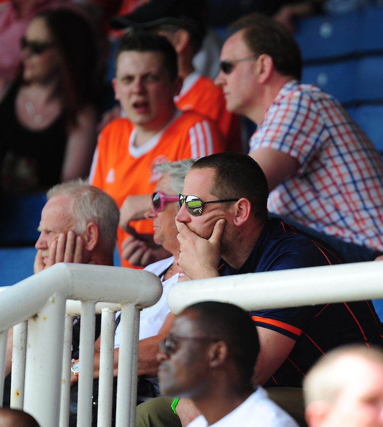 Blackpool fans look dejected during the second half as time ticks away on their sides battle to avoid relegation<br /> <br /> Photographer Chris Vaughan/CameraSport<br /> <br /> Football - The Football League Sky Bet League One - Peterborough United v Blackpool  - Sunday 8th May 2016 - ABAX Stadium - London Road   <br /> <br /> &copy; CameraSport - 43 Linden Ave. Countesthorpe. Leicester. England. LE8 5PG - Tel: +44 (0) 116 277 4147 - admin@camerasport.com - www.camerasport.com