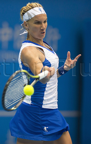 03.10.2014. Beijing, China.  Svetlana Kuznetsova of Russia returns the ball during for womens quarterfinal match against her compatriot Maria Sharapova at the China Open tennis tournament in Beijing, China, Oct. 3, 2014. Svetlana Kuznetsova lost 0-2.