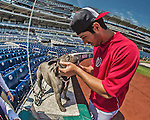 26 April 2014: Washington Nationals pitcher Gio Gonzalez holds his dog Stitch, a French Bulldog, prior to a game against the San Diego Padres at Nationals Park in Washington, DC. The Nationals defeated the Padres 2-1 to take the third game of their 4-game series. Mandatory Credit: Ed Wolfstein Photo *** RAW (NEF) Image File Available ***
