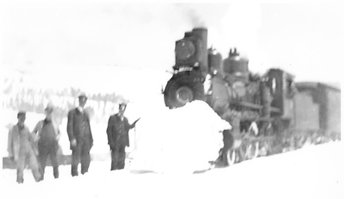 A 4-6-0 pulling a passenger train has accumulated a fair amount of snow on her pilot.<br /> D&amp;RG