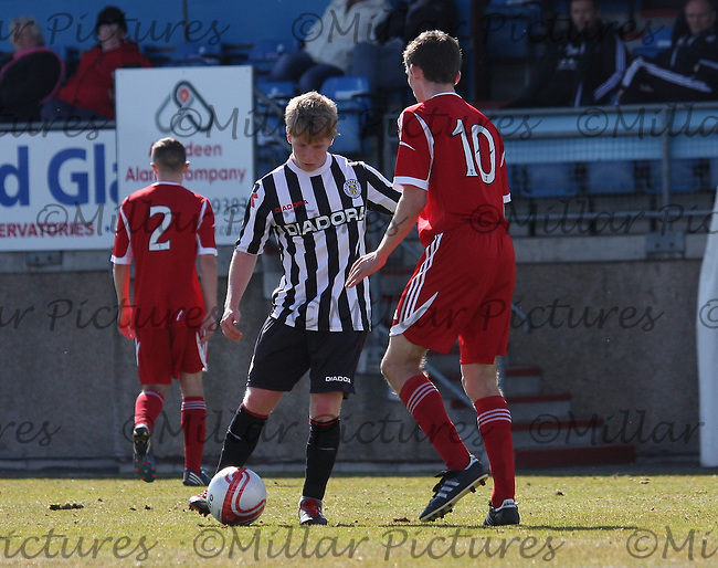 Jon Scullion takes on Kieran Gibbons in the Aberdeen v St Mirren Clydesdale Bank Scottish Premier League Under 20 match played at Balmoor Stadium, Peterhead on 19.4.13.