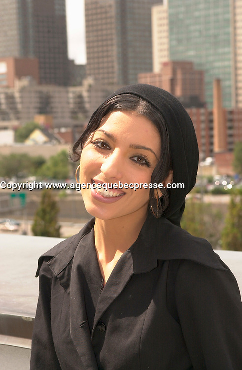 August 28,  2003, Montreal, Quebec, Canada<br /> <br /> Iranian Film maker Samira Makmalbaf, pose for an exclusive photo in front of Montreal downtown, august 28 2003, she preside the Jury for 1st movie of the World Film Festival<br /> <br /> <br /> The Festival runs from August 27th to september 7th, 2003<br /> <br /> <br /> Mandatory Credit: Photo by Pierre Roussel- Images Distribution. (&copy;) Copyright 2003 by Pierre Roussel <br /> <br /> All Photos are on www.photoreflect.com, filed by date and events. For private and media sales