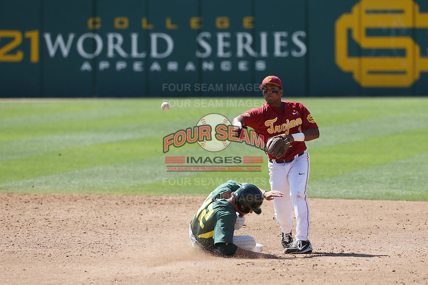 Dante Flores (3) of the Southern California Trojans throws to first base after forcing out Phil Craig-St.Louis (42) of the Oregon Ducks at second base during a game at Dedeaux Field on April 18, 2015 in Los Angeles, California. Oregon defeated Southern California, 15-4. (Larry Goren/Four Seam Images)