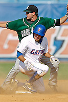 June 03, 2011:   Florida Gators outfielder Tyler Thompson (18) slides under the tag of Florida Gators outfielder Tyler Thompson (18) during NCAA Gainesville Regional action between Manhattan Jaspers  and Florida Gators played at Alfred A. McKethan Stadium on the campus of Florida University in Gainesville, Florida.  Florida defeated Manhattan 17-3.........
