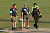 Umpire Mike Burns speaks to the ground staff as the low sun causes play to be suspended during Kent Spitfires vs Essex Eagles, Vitality Blast T20 Cricket at the St Lawrence Ground on 2nd August 2018