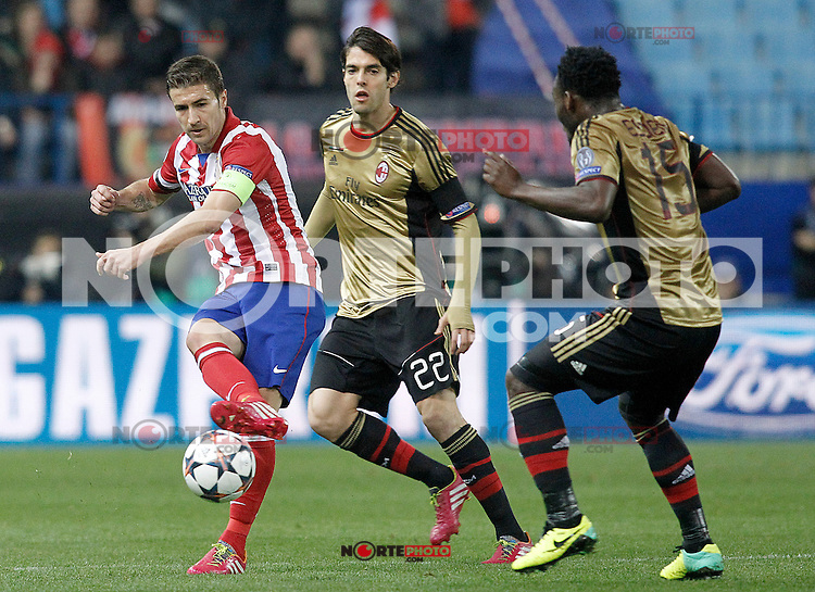 Atletico de Madrid's Gabi Fernandez (l) and AC Milan's Kaka (c) and Michael Essien during Champions League 2013/2014 match.March 11,2014. (ALTERPHOTOS/Acero)