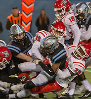 Southside's Jay Washington is tackled by Northside's defense during Friday's game at Fort Smith Southside.