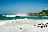 USA, Hawaii, waves in the ocean against clear blue sky at Waimea bay, the Eddie Aikau surf competition