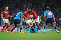 Mathieu Bastareaud of France attempts to hand off Samuela Vunisa of Italy during Match 5 of the Rugby World Cup 2015 between France and Italy - 19/09/2015 - Twickenham Stadium, London <br /> Mandatory Credit: Rob Munro/Stewart Communications