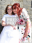 Olivia McKenna who recieved first holy communion in the church of Mary Immaculate collon pictured with her mother Claire Keelan. Photo:Colin Bell/pressphotos.ie
