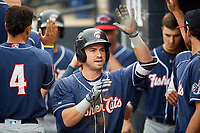New Hampshire Fisher Cats designated hitter Jon Berti (11) is congratulated by his teammates in the dugout after hitting a home run in the top of the fifth inning during a game against the Trenton Thunder on August 19, 2018 at ARM & HAMMER Park in Trenton, New Jersey.  New Hampshire defeated Trenton 12-1.  (Mike Janes/Four Seam Images)