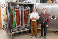 From left, physics professor Daniel Snowden-Ifft and post doctoral fellow Jean-Luc Gauvreau stand next to the dark matter detector in the physics department, Hameetman Science Center, Nov. 21, 2013. (Photo by Marc Campos, Occidental College Photographer)