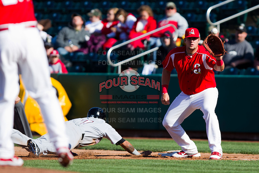 Matthew Adams (25) of the Springfield Cardinals catches a pickoff attempt during a game against the Frisco RoughRiders on April 16, 2011 at Hammons Field in Springfield, Missouri.  Photo By David Welker/Four Seam Images