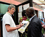 A Belgian doctor from the group DDK reviews an endoscopy report with a paitent at Gisenyi Community Hospital in northwest Rwanda.