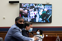 US Navy veteran and Black Lives Matter protester Kishon McDonald (L) and George Washington University Law School Law Professor Jonathan Turley (R) watch video footage of clashes between police and protesters; during the US House Natural Resources Committee hearing on 'The US Park Police Attack on Peaceful Protesters at Lafayette Square', on Capitol Hill in Washington, DC, USA, 29 June 2020. The death of George Floyd while in Minneapolis police custody has sparked protests demanding policing reform and racial equality. Amidst protests authorities cleared Lafayette Square, 01 June 2020, before US President Donald J. Trump walked across the park and visited St. John's Church.<br /> Credit: Michael Reynolds / Pool via CNP / MediaPunch