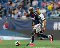 FOXBOROUGH, MA - JUNE 27: Wilfried Zahibo #23 dribbles at midfield as Kacper Przybylko #23 pressures during a game between Philadelphia Union and New England Revolution at Gillette Stadium on June 27, 2019 in Foxborough, Massachusetts.